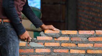 start laying bricks